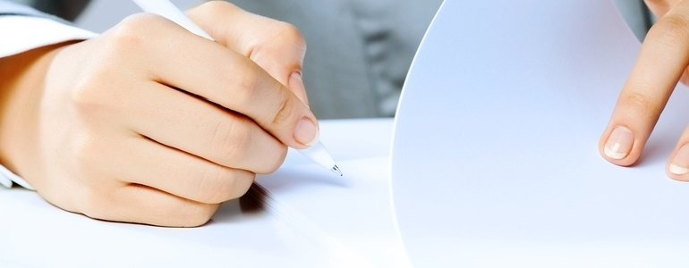 Close up image of businesswoman hands signing documents-820215-edited.jpeg